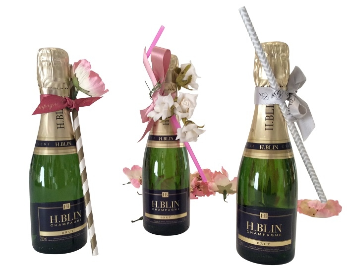 Miniature-Champagne-Wedding-Favours-with-Pretty-Pink-Flowers