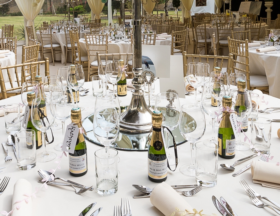 Champagne-wedding-favours-in-marquee